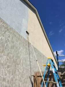 A USA Painting rolling 2-story stucco house Jax FL 2019
